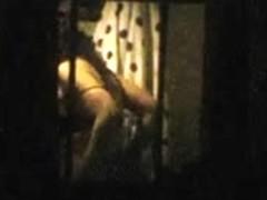 Window voyeur, brunette in bra
