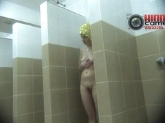 Cute broad caught on a voyeur cam while in the shower