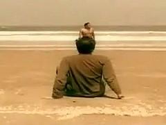 Undressed lad in beach