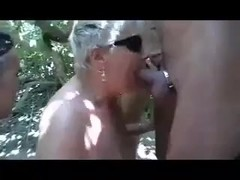Granny at the beach engulfing every cock she see.