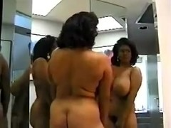 Black woman with amazing body dancing in mirror