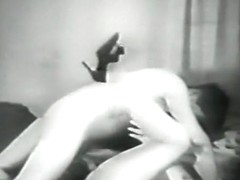 Horny chick fingers her pussy in a black and white porn