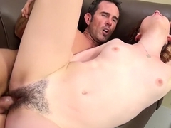 Bitch with a hairy cunt sucks and gets a good hard dicking on the couch