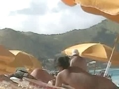 Beach voyeur video of a nude milf and a nude Asian hottie