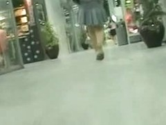 Upskirt voyeur gets into hot brunette's panties