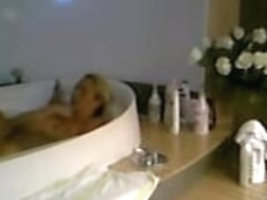 Amateur female is relaxing in the bath on hidden cam