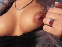 Zuzana demonstrates her precious boobs outdoors