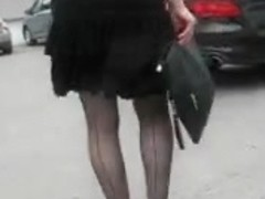 Girl in seamed stockings in a windy day 2