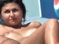 Spying on hawt topless dark brown at the beach