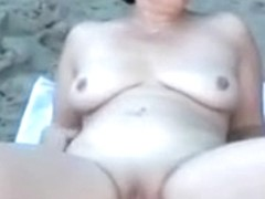 My perfect wife taking sunbath on the nudist beach