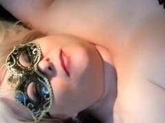 Older blonde large adorable woman white lady in mask blows a sex-toy