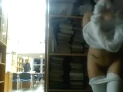 College beauty flashing in the library