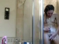 girl captures herself showering and shaving her pussy