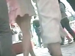 Two booty babes in a crowded shopping district upskirt porno