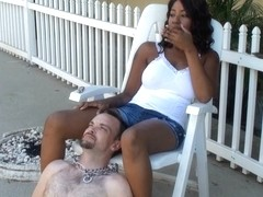 White guy is used as personal ash tray by an ebony girl