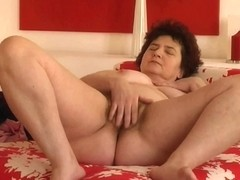 Plump granny with large zeppelins and bushy cum-hole