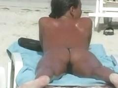 Nude beach hidden cam shoots the sexiest tan oiled bodies