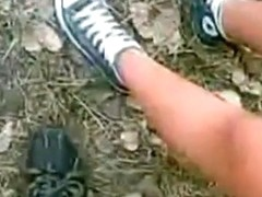 2 latina girls suck off a guy in nature. he cums on one's tits and the other girl cleans it up.