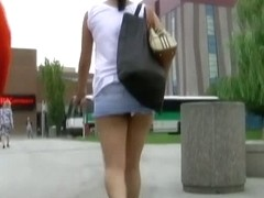 Brunette chick's upskirt teen ass