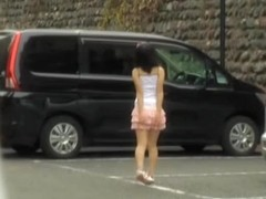 Asian teen bends over and shows horny upskirt in the street