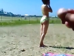 Ejaculating on a topless woman on the beach