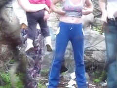 Amateur women go pee in a public spot