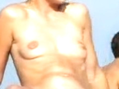 Skinny girl shows her tits and pussy on the nude beach