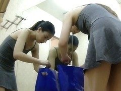 Changing dressing room girl uncovers tits and beaver