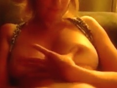 I capture my busty gf playing with her big tits and shaved pussy on the sofa