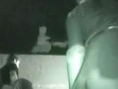 Dancing slut in a dark club shakes her ass for a voyur hidden upskirt cam