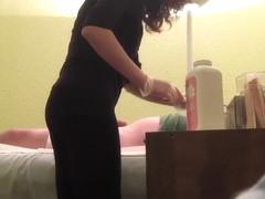 Hidden cam reveals a wax master giving handjob to horny client