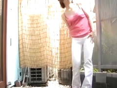 Japanese girl pees her pants after trying to hold it