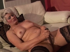 Lonely mature mom masturbating on the couch with dildo