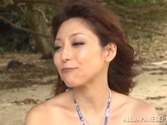 Yuuko Shiraki enjoys sex oudoors in the sand