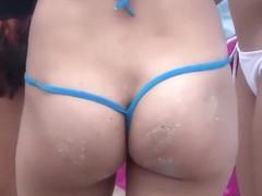 G-string bikini on a tasty Brazilian at the beach