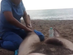 Hairy guy gets a leg massage on the beach
