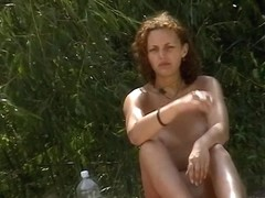 Two naked babes taking sunbaths in best nude beach video