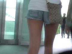 Street candid with very beautiful teens in tight shorts