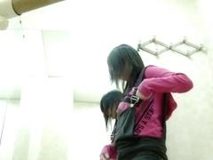 A fresh Asian ballet dancer fully strips in the dressing room