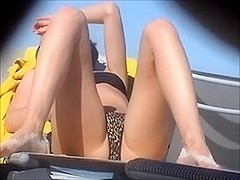 Spying on unbelievably hot seductress on the summer beach