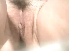 Beach porno of a hairy white large lipped pussy bathing in the sun