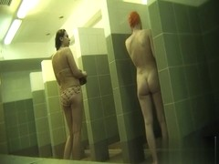 Hidden cameras in public pool showers 9