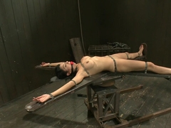 Bound by metal, covered in wax, fucked by machine