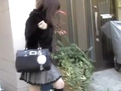 Big booty Asian bimbo gets spanked while taking street walk