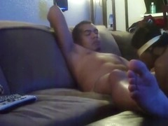 Latino gets blindfolded blowjob on sofa