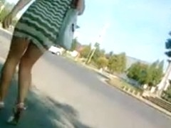 Hot slut in miniskirt caught in street candid video