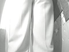 Plump bottomed Asian MILF filmed pissing on the toilet