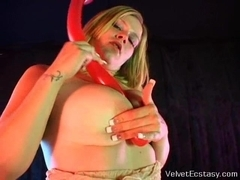 Curvy blonde plays with a huge red dildo