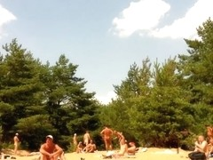 Naked people enloyong the sun on the beach