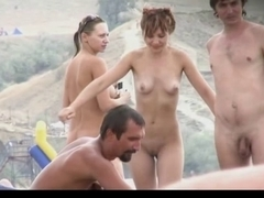 Slender legal age teenager with merry bumpers stripped at a nudist beach